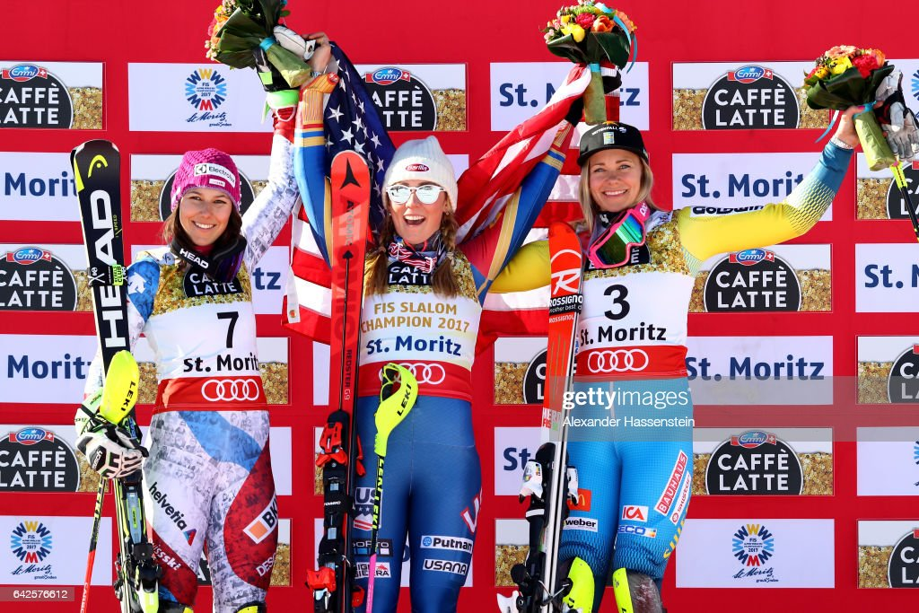 Silver medallist Wendy Holdener of Switzerland (L) poses with gold medallist Mikaela Shiffrin of The United States (C) and bronze medallist Frida Hansdotter of Sweden (R) during the flower ceremony after the Women's Slalom during the FIS Alpine World Ski Championships on February 18, 2017 in St Moritz, Switzerland.