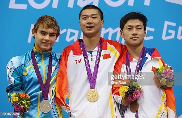 Silver medallist Yevheniy Bohodayko of Ukraine gold medallist Shiyun Pan of China and bronze medallist Jingang Wang of China pose on the podium...