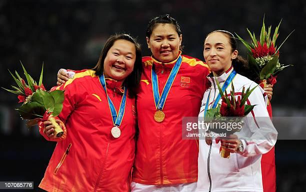 Silver medallist Zheng Wang of China, Gold medallist Wenxiu Zhang of China and Bronze medallist Yuka Murofushi of Japan in the Women's Hammer Throw...