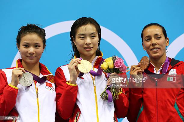 Silver medallist Zi He of China gold medallist Minxia Wu of China and bronze medallist Laura Sanchez Soto pose on the podium in the medal ceremony...
