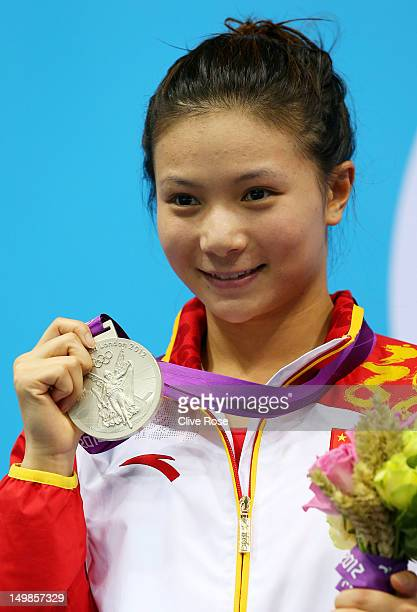 Silver medallist Zi He of China poses on the podium in the medal ceremony for the Women's 3m Springboard Diving final on Day 9 of the London 2012...
