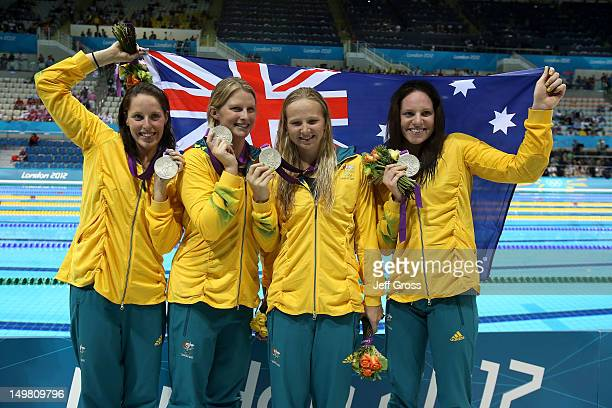 Silver medallists Alicia Coutts, Leisel Jones, Melanie Schlanger and Emily Seebohm of Australia pose following the medal ceremony for the Women's...
