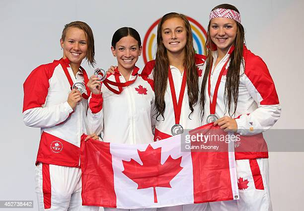 Silver medallists Alyson Ackman Samantha Cheverton Emily Overholt and Brittany Maclean of Canada pose on the podium during the medal ceremony for the...
