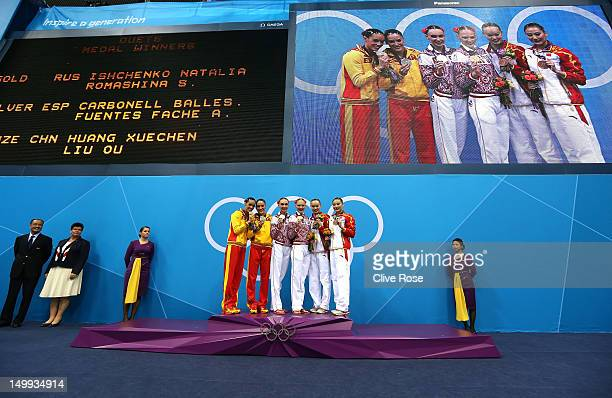 Silver medallists Ballestero Carbonell and Andrea Fuentes Fache of Spain gold medallists Natalia Ishenko and Svetlana Romashina of Russia and bronze...