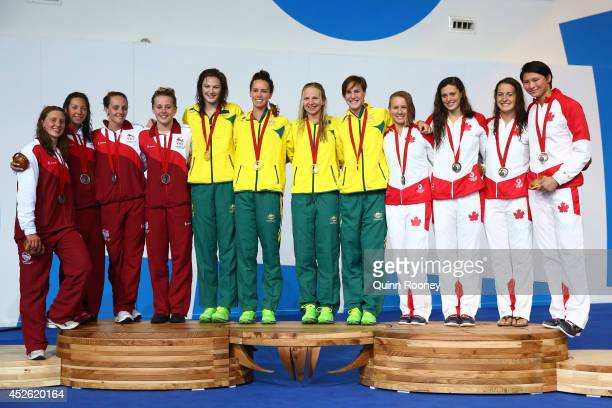 Silver medallists Becki Turner Amy Smith Francesca Halsall and Siobhan O'Connor of England pose with gold medallists Cate Campbell Emma McKeon...