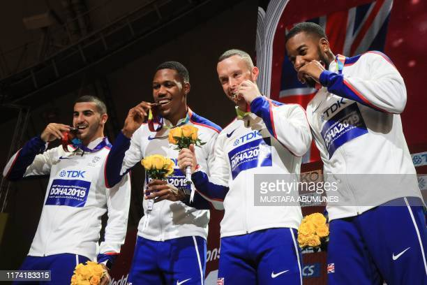 Silver medallists Britain's Adam Gemili Zharnel Hughes Richard Kilty and Nethaneel MitchellBlake pose on the podium during the medal ceremony for the...