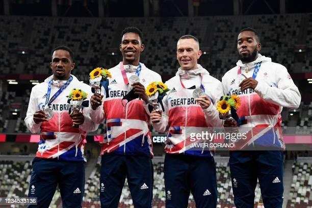 Silver medallists Britain's Chijindu Ujah, Britain's Zharnel Hughes, Britain's Richard Kilty, Britain's Nethaneel Mitchell-Blake, celebrate on the...