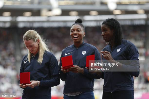 Silver medallists Britain's Eilidh Doyle Margaret Adeoye and Christine Ohuruogu pose on the podium during the medal reallocation victory ceremony for...
