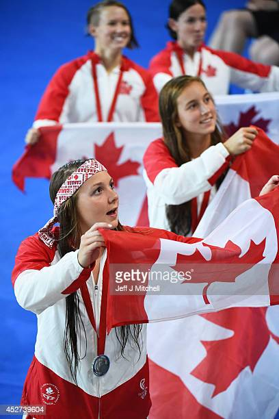 Silver medallists Brittany Maclean leads the celebrations with Emily Overholt Alyson Ackman and Samantha Cheverton of Canada after the Women's 4 x...