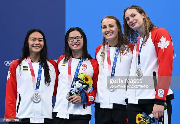 Silver medallists Canada's Penny Oleksiak, Canada's Rebecca Smith, Canada's Margaret Macneil and Canada's Kayla Sanchez pose on the podium after the...