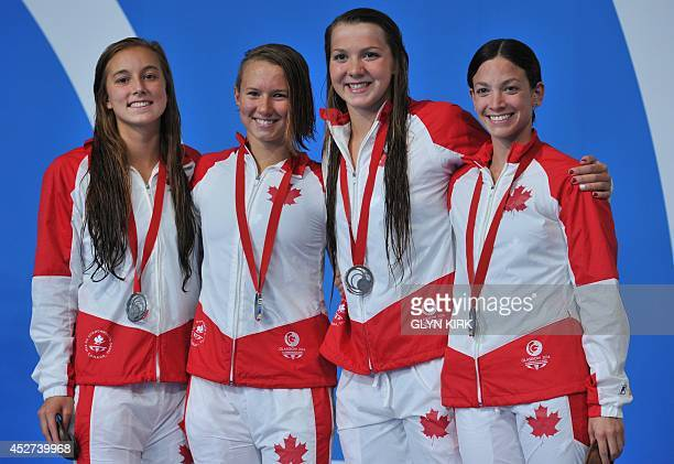 Silver medallists Canada's Samantha Cheverton Brittany Maclean Alyson Ackman and Emily Overholt pose on the podium during the Women's 4 x 200m...