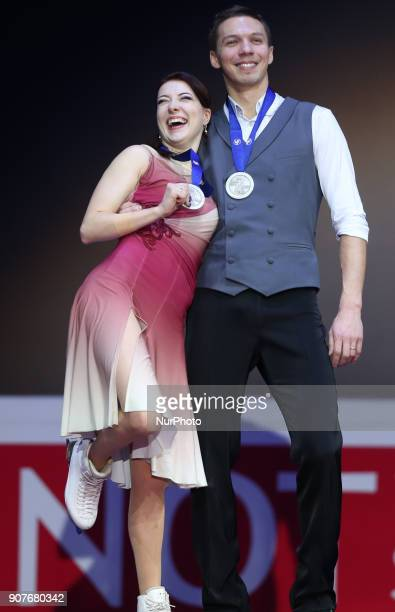 Silver medallists Ekaterina Bobrova and Dmitri Soloviev of Russia pose with their medals after the ice dance free dance at the ISU European Figure...