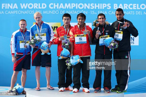 Silver medallists Evgeny Kuznetsov and Ilia Zakharov of Russia gold medallists Qin Kai and He Chong of China and bronze medallists Jahir Ocampo and...