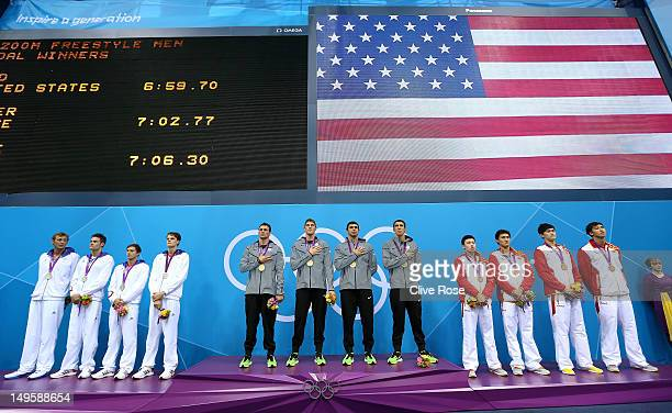 Silver medallists France gold medallists the United States and bronze medallists China pose on the podium during the medal ceremony for the Men's 4 x...