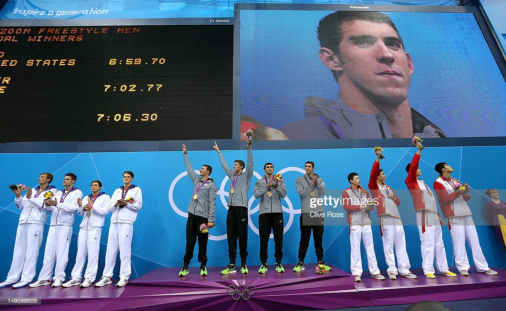 Silver medallists France, gold medallists the United States and bronze medallists China pose on the podium during the medal ceremony for the Men's 4 x 200m Freestyle Relay final on Day 4 of the London 2012 Olympic Games at the Aquatics Centre on July 31, 2012 in London, England.