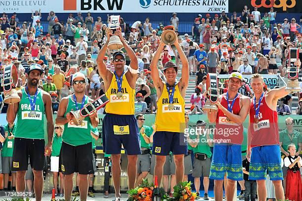 Silver medallists from Brazil Pedro Solberg and Bruno Schmidt gold medallists from Brazil Ricardo Santos and Alvaro Filho bronze medallists from USA...