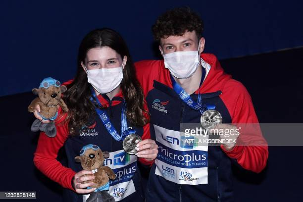 Silver medallists Great Britain's Andre Spendolini-Sirieix and Noah Williams pose with their medals during the podium ceremony after the Mixed...