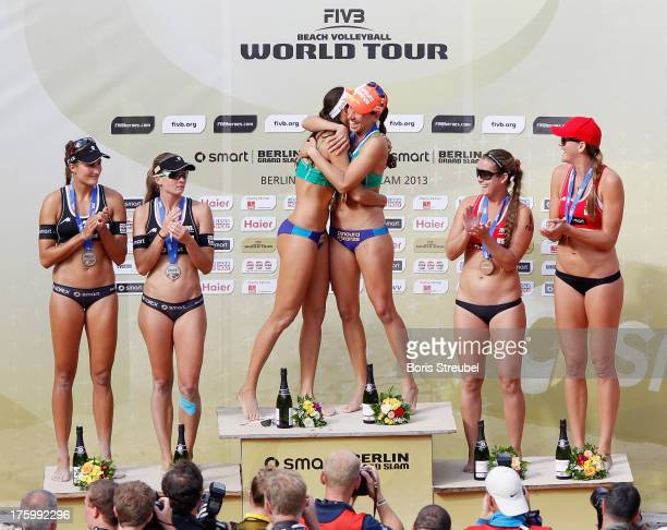 Silver medallists Ilka Semmler and Katrin Holtwick of Germany gold medallists Talita Da Rocha Antunes and Taiana Lima of Brazil and bronze medallists...