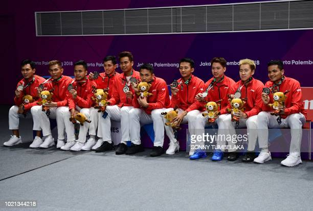 Silver medallists Indonesia celebrate during the victory ceremony for the men's team badminton event at the 2018 Asian Games in Jakarta on August 22...