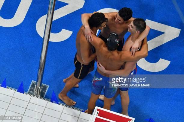 Silver medallists Italy's Alessandro Miressi, Italy's Thomas Ceccon, Italy's Lorenzo Zazzeri and Italy's Manuel Frigo celebrate winning the silver...