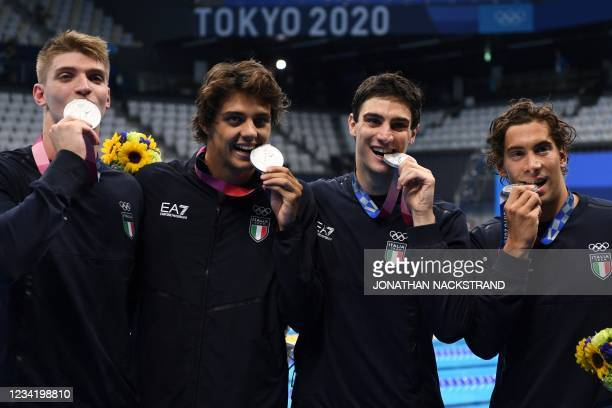 Silver medallists Italy's Alessandro Miressi, Italy's Thomas Ceccon, Italy's Lorenzo Zazzeri and Manuel Frigo pose with their medals after the final...
