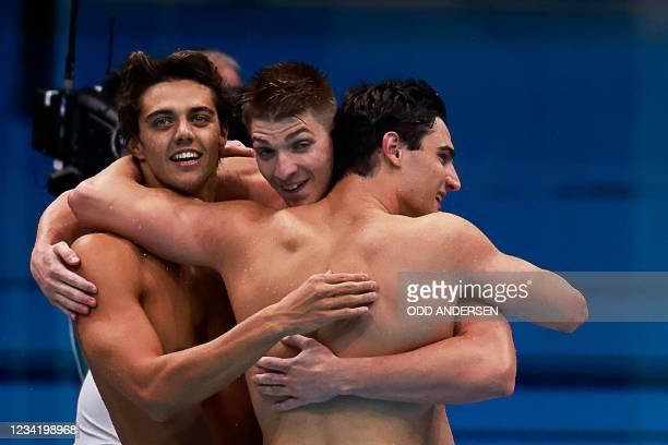 Silver medallists Italy's Alessandro Miressi, Italy's Thomas Ceccon, Italy's Lorenzo Zazzeri react as Italy's Manuel Frigo touched home second to...
