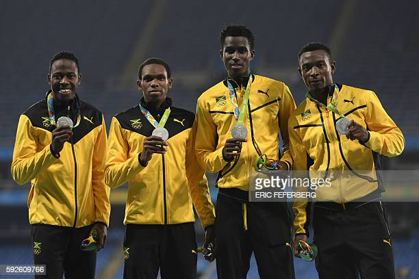 Silver medallists Jamaica's Javon Francis Jamaica's Fitzroy Dunkley Jamaica's Nathon Allen and Jamaica's Peter Matthews pose on the podium of the...