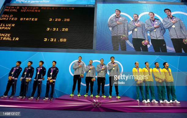 Silver medallists Japan gold medallists the United States and bronze medallists Australia pose on the podium in the medal ceremony for the Men's...