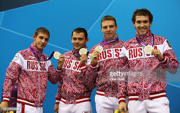 Silver medallists Konstantin Lisenkov Pavel Poltavtsev Eduard Samarin and Denis Tarasov of Russia pose on the podium during the medal ceremony for...