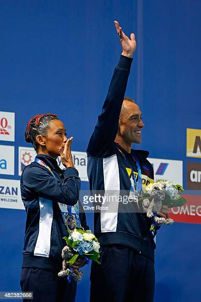Silver medallists Kristina LumUnderwood and Bill May of the United States celebrate during the medal ceremony in the Mixed Duet Free Synchronised...