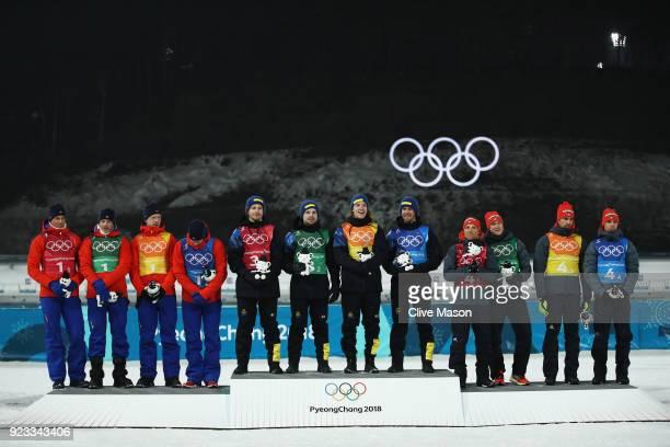 Silver medallists Lars Helge Birkeland Tarjei Boe Johannes Thingnes Boe and Emil Hegle Svendsen of Norway pose with gold medallists Peppe Femling...