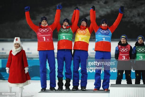 Silver medallists Lars Helge Birkeland Tarjei Boe Johannes Thingnes Boe and Emil Hegle Svendsen of Norway celebrate during the victory ceremony for...