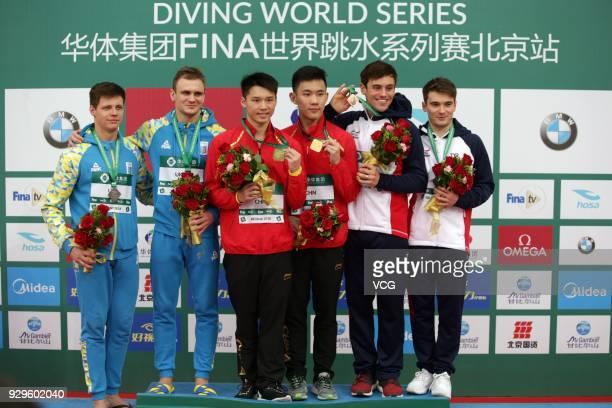 Silver medallists Maksym Dolgov and Oleksandr Gorshkovozov of Ukraine gold medallists Chen Aisen and Yang Hao of China bronze medallists Thomas Daley...