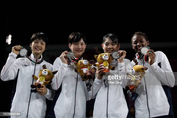 Silver medallists members of team Japan pose for photo during Women's Basketball 3X3 medal ceremony on day eight of the Asian Games on August 26,...