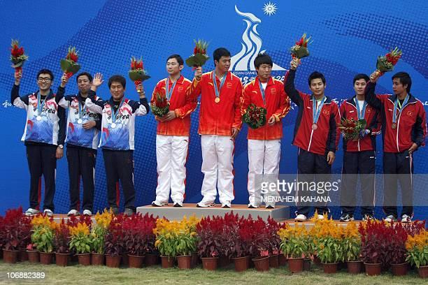 Silver medallists of South Korea Cha Sang Jun Hong Seong Hwan Hwang Yoonsam Gold medalists Ding Feng Li Yuehong and Zhang Jian of China and Bronze...