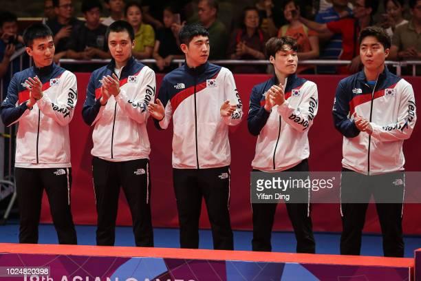 Silver medallists of team South Korea Lee Sangsu, Jeung Young Sik, Kim Donghyun, Jang Woojin and Lim Jonghoon during Men's Table Tennis Team medal...