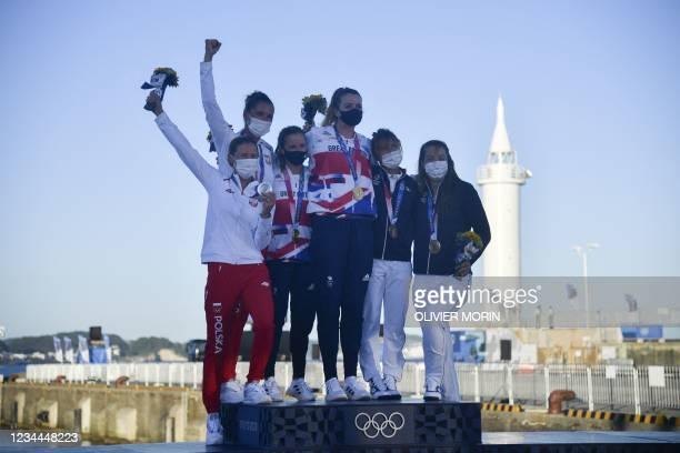 Silver medallists Poland's Agnieszka Skrzypulec and Jolanta Ogar, gold medallists Britain's Hannah Mills and Eilidh Mcintyre, and bronze medallists...