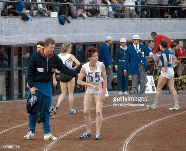 Silver medallists Robbie Brightwell of Great Britain with Ann Packer of Great Britain who later became his wife at the Summer Olympic Games in Tokyo...