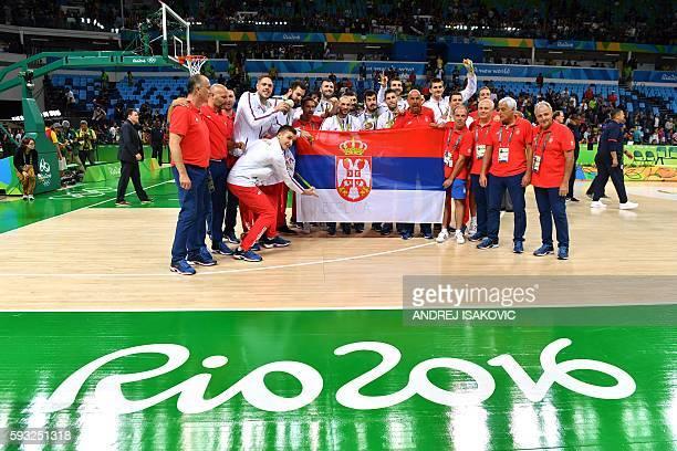 Silver medallists Serbia's guard Milos Teodosic Serbia's forward Marko Simonovic Serbia's shooting guard Bogdan Bogdanovic Serbia's point guard...