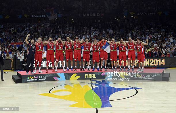 Silver medallists Serbia's players celebrate on the podium after winning the 2014 FIBA World Cup Final basketball match between USA and Serbia at the...