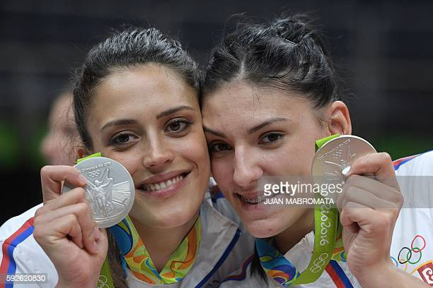 Silver medallists Serbia's Tijana Boskovic and Serbia's Stefana Veljkovic pose on the podium after the women's Gold Medal volleyball match at...