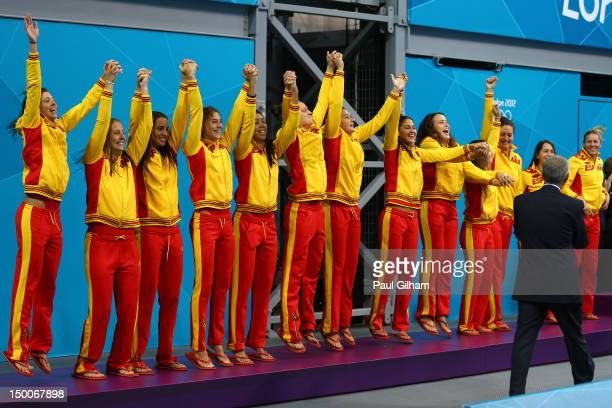 Silver medallists Spain celebrate on the podium during the medal ceremony for the Women's Water Polo on Day 13 of the London 2012 Olympic Games at...