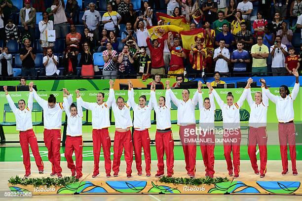 Silver medallists Spain's point guard Leticia Romero Spain's power forward Astou Ndour Spain's power forward Laura Gil Spain's forward Laura Quevedo...