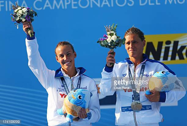 Silver medallists Tania Cagnotto and Francesca Dallape of Italy pose with their medals and the offical mascot XOP after the Women's 3m Springboard...
