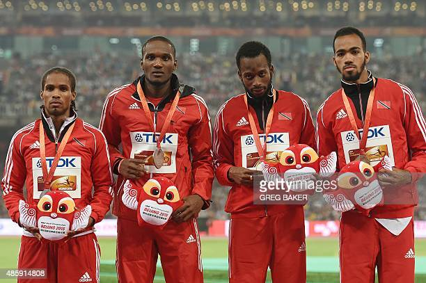 Silver medallists Trinidad and Tobago's Machel Cedenio Deon Lendore Lalonde Gordon and Renny Quow pose with their medals on the podium during the...