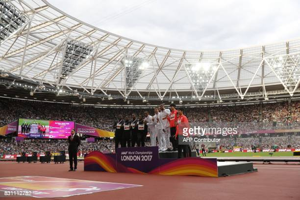 Silver medallists US athlete Justin Gatlin Mike Rodgers Christian Coleman and Jaylen Bacon gold medallists Britain's Chijindu Ujah Adam Gemili Daniel...