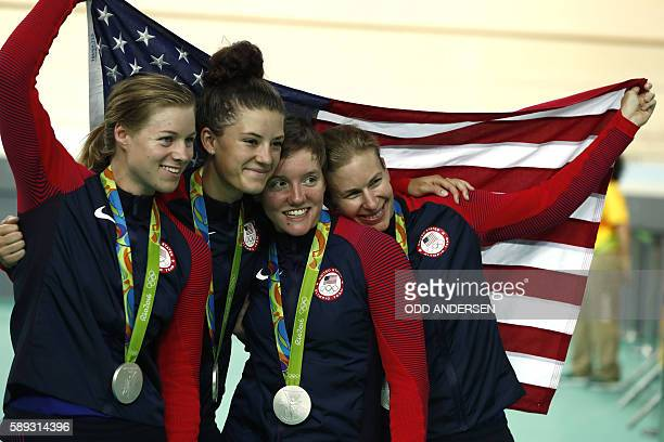 Silver medallists USA's Jennifer Valente USA's Chloe Dygert USA's Kelly Catlin and USA's Sarah Hammer pose with a flag and their medals on the podium...