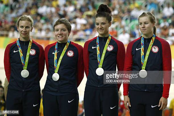 Silver medallists USA's Sarah Hammer USA's Kelly Catlin USA's Chloe Dygert and USA's Jennifer Valente pose on the podium after the women's Team...