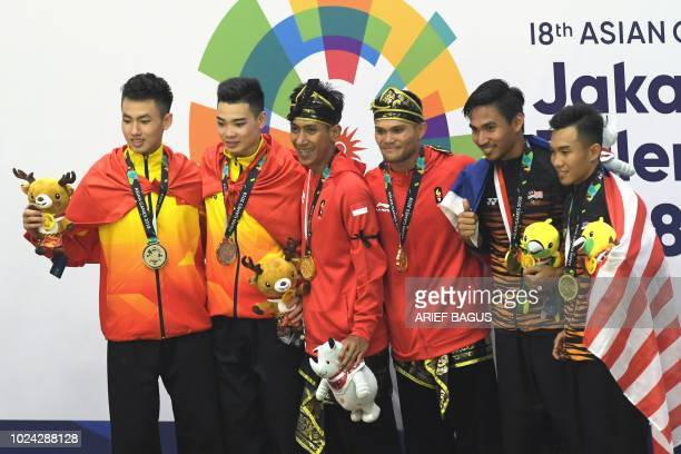 Silver medallists Vietnam's Tran Duc Danh and Le Hong Quan, gold medallists Indonesia's Hendy and Yola Primadona Jampil and bronze medallists...