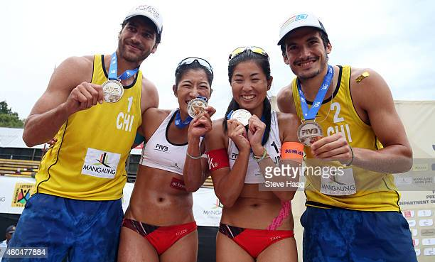 Silver medals Marco Grimalt and Esteban Grimalt of Chili pose with silver medal winners Sayaka Mizoe and Takemi Nishibori of Japan during Day 6 of...